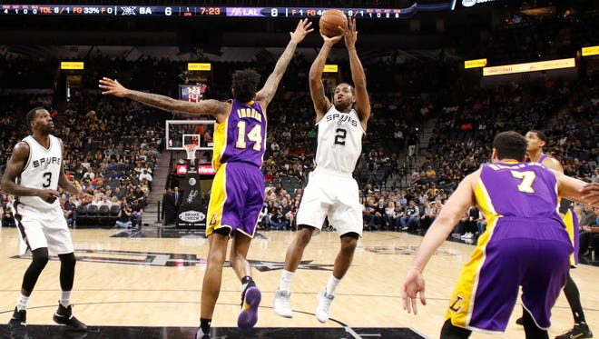San Antonio Spurs small forward Kawhi Leonard (2) shoots the ball over Los Angeles Lakers small forward Brandon Ingram (14) during the first half at AT&T Center.