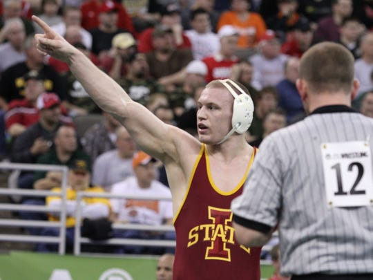 Iowa State's Jake Varner celebrates his victory over Cornell's Cam Simaz in their 197 pound match during the NCAA Wrestling Championships at the Qwest Center in Omaha Friday evening.