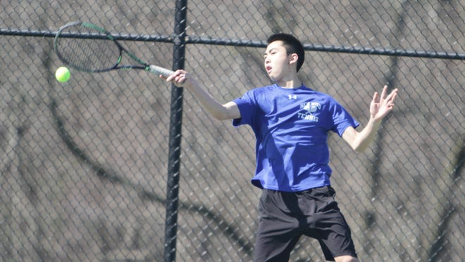 Hen Hud's Jonathan Chung hits a forehand shot during the San Marco Tournament at Harrison High School on Sunday, April 17th, 2016.