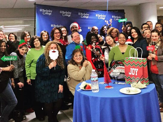 Berkeley College alumni and officials gather to celebrate the holidays and collect toy donations for children in need.