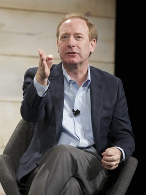 Microsoft General Counsel and Executive Vice President Brad Smith speaks during the question and answer session of the Microsoft Shareholders Meeting December 3, 2014 in Bellevue, Washington.