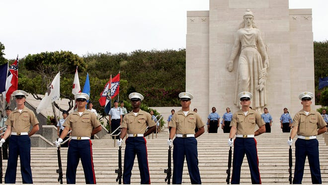 In this 2005 file photo, the U.S. Marine ceremonial rifle team stand at attention during the Memorial Ceremony at the National Memorial Cemetery of the Pacific May 30, 2005 in Honolulu, Hawaii.