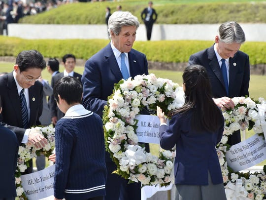 Secretary of State John Kerry, center, Japan's Foreign