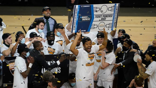 The Cleveland State basketball team celebrates its Horizon League Tournament title and a berth in the NCAA  Tournament on Tuesday night in Indianapolis. [Darron Cummings/Associated Press]