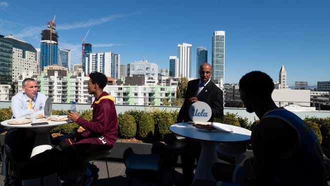 Arizona State head coach Bobby Hurley and junior guard Tra Holder sit atop the roof deck during Pac-12 men's basketball media day at Pac-12 Networks on Oct. 20, 2016.