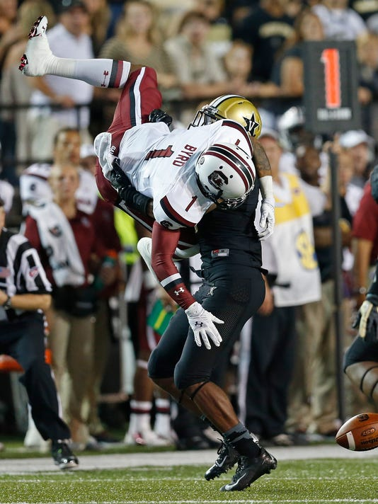 Vanderbilt defensive back Torren McGaster breaks up a pass intended for South Carolina wide receiver Damiere Byrd (1) during the fourth quarter of an NCAA college football game Saturday, Sept. 20, 2014, in Nashville, Tenn. South Carolina won 48-34. (AP Photo/Mark Humphrey)