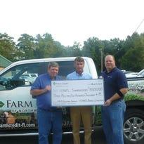 From left, Farm Credit of Northwest Florida directors Radford Locklin Jr., Glen Strange and Damon Boutwell celebrate returning more than $3.5 million to members via its patronage refund program.