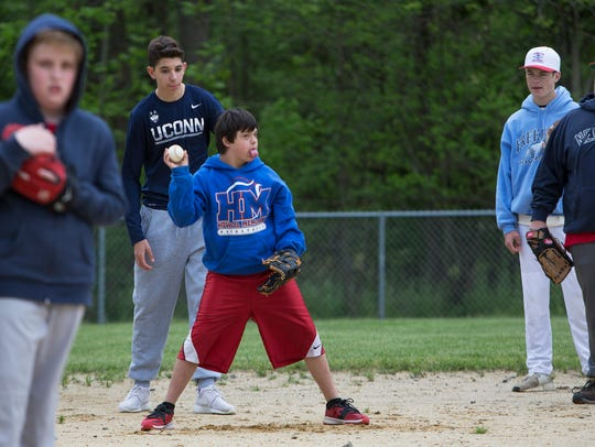 Nicholas Labollita, 11, of Howell scoops up the ball