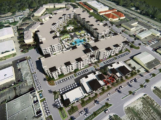 An aerial rendering shows three five-story condominium buildings planned for the long vacant site of the old Naples Daily News building.