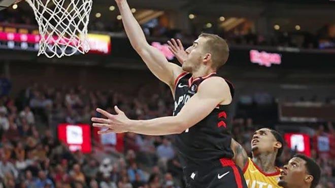 Toronto Raptors guard Matt Thomas scores against Utah Jazz March 9 in Salt Lake City.