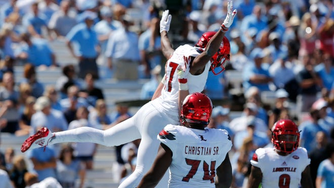 Louisville's Dez Fitzpatrick is lifted in the air after scoring his teams first touchdown against UNC. Sept. 9, 2017.