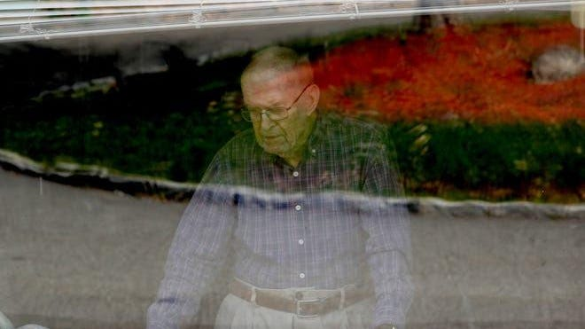 Charles Hutton, 95, a resident of Tappan Zee Manor, an assistant living facility in Nyack, looks out the window of his room in April. While the facility has not permitted residents to have visitors since the start of the coronavirus pandemic, it was announced Friday that limited visitation can begin again.