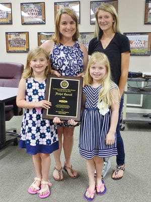 Nichol Carroll, Cumberland Regional High School's Teacher of the Year, displays her recognition plaque with daughters, Riley and Julia, and Kay Hyson, ab officer for the Future Farmers of America chapter, at CRHS.