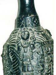 This black Mexican water jug probably was made in the mid-20th century.