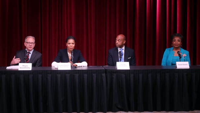 Mayor Briley, Council Member Erica Gilmore, State Rep. Harold Love Jr. and Carol Swain participate in a mayoral candidate forum hosted by The Tennessean and WSMV at the Nashville Public Library Downtown branch Wednesday May 2, 2018.