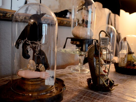 Martha Kohley has assembled collections of curiosities under glass domes for her Saturday sale.