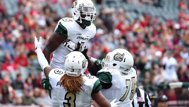 Charlotte, picked as one of the worst teams in Conference USA, just beat perennial power Marshall over the weekend.