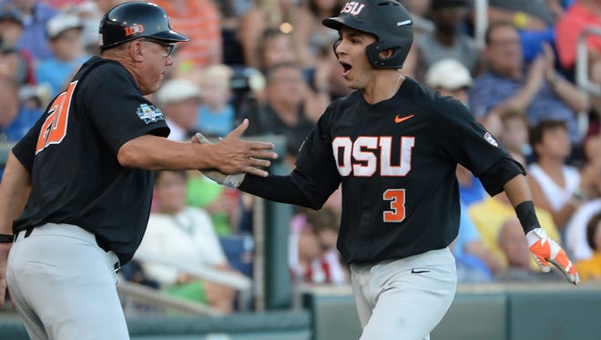 Jun 19, 2017; Omaha, NE, USA; Oregon State infielder Nick Madrigal (3) scores against LSU in the 2017 College World Series at TD Ameritrade Park.