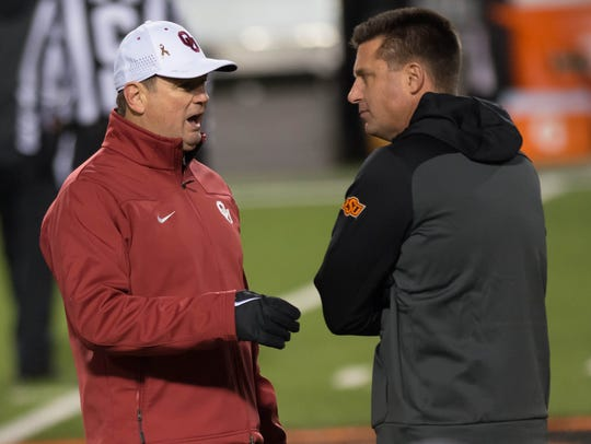 Oklahoma coach Bob Stoops and Oklahoma State coach