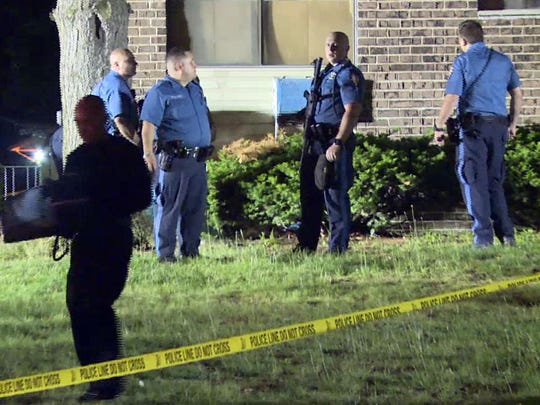 Lakewood Police officers investigate the scene of a multiple shooting early Wednesday, June 10, 2015, at the High Point condo complex. LAKEWOODSHOOTING0610A