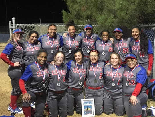 The Cooper softball poses with its medals after winning