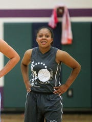 Iowa's Alexa Kastanek, left, and incoming freshman Tania Davis wait for free throws during their teams' Game Time League game at the North Liberty Community Center on Wednesday, June 17, 2015. David Scrivner / Iowa City Press-Citizen