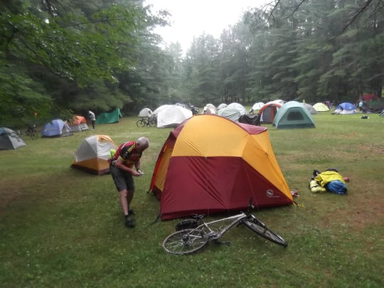 Jeffrey Rice of Rochester Hills breaks camp at Hartwick Pines State Park in Grayling on the penultimate morning of Michigander 24, July 17.  Rice, a five-time tour vet who rode the 364-mile 8-Day option, celebrated his 25th wedding anniversary with his wife Debbie, a 2-Day rider, and their 'Gander friends at Short's Brewing Company in Bellaire on July 14.