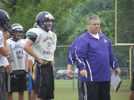 Kewaunee senior quarterback Noah Kleiman and head coach