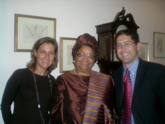 Moss and his wife, Donna, with Liberian president Ellen