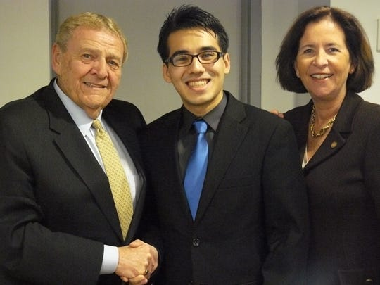 Victor M. Richel, Chair of the Union County College Board of Trustees, congratulates Nuno Pereira (center) on his appointment, along with Union County College President Margaret M. McMenamin.