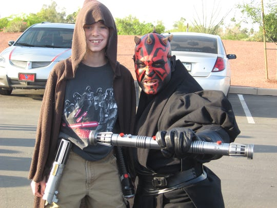 A temporary truce between a young Jedi and the evil Darth Maul during an event featuring the 501st Legion of Imperial Stormtroopers.