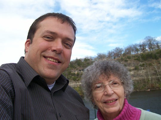 Doug Seubert, left, and his mother, Marge Seubert, pose for a photo in 2007 during a trip to Branson, Missouri.