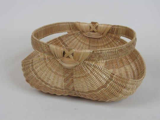 A detailed white oak basket created by artist Leona