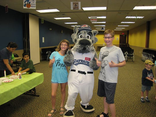 Somerset Patriots mascot Sparkee visited SCLSNJ's Hillsborough Library branch on July 25 to meet with library patrons and staff. The visit was coordinated by Mary Nunn and Amy Atzert, both from SCLSNJ's Hillsborough Library branch youth services department. Atzert is the new youth services department supervisor. Pictured with Sparkee are Annika and Benjamin West.