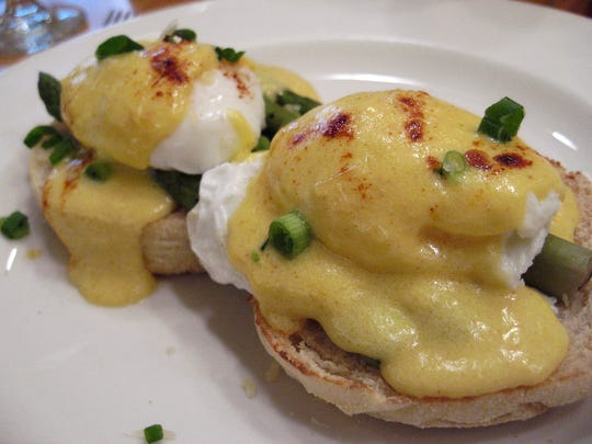 The Eggsparagus Benedict at the new Hudson Cafe in downtown Detroit features steamed asparagus spears, parmesan and Hollandaise on an English muffin.  Photo taken Oct 27 2011.