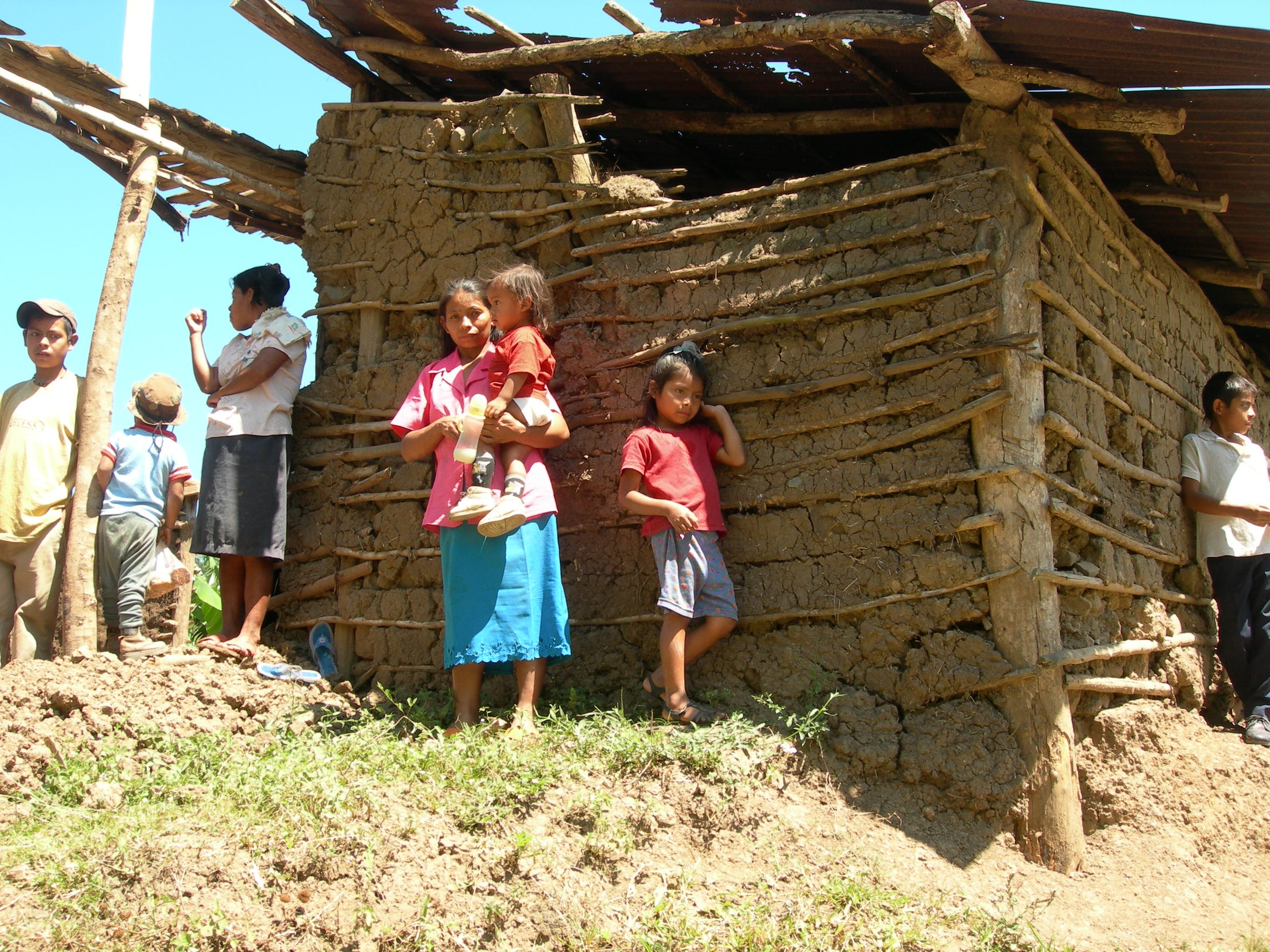 This family lives in a home built of mud and sticks.