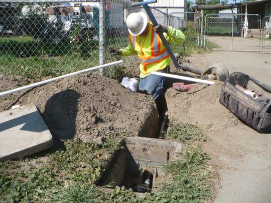 West Valley Construction worker Tim Goodman works on