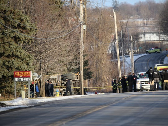 A Gananda school bus overturned after being hit by a passenger vehicle on Route 31F in Macedon, Wayne County, Thursday. Seven students suffered minor injuries.