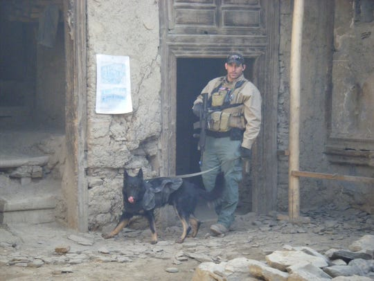 Dan Hughes is shown with his working dog K-9 Adak at