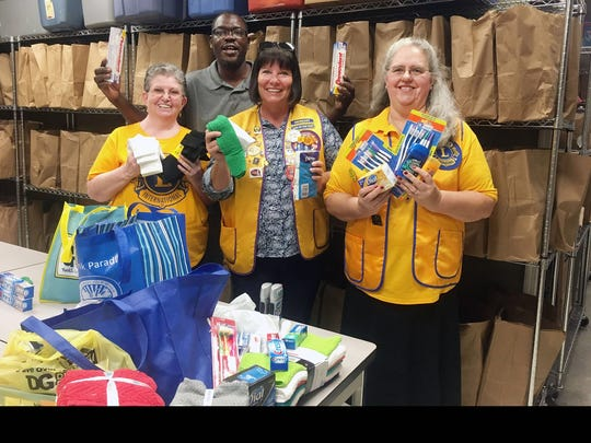 Lions Club members recently collected items for distribution to individuals and families who come to Mustard Seed Ministries.