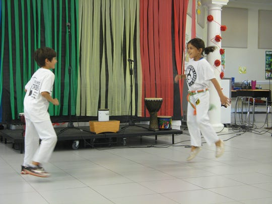 Students demonstrated capoeira, an Afro-Brazilian martial