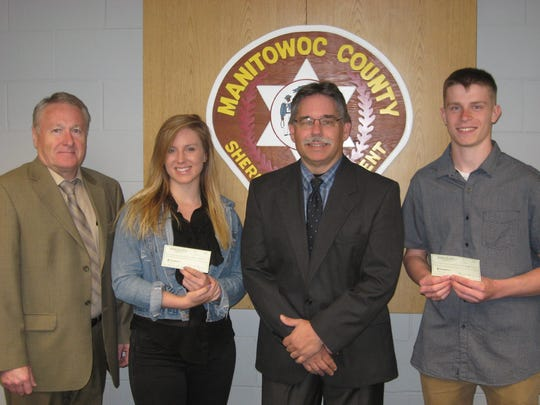 Mariah Zahn and Tanner Jost both received $500 scholarships from the Manitowoc County Sheriff's Department Association. Pictured, from left: Manitowoc County Sheriff Robert Hermann, Zahn, Association President Keith Bonde and Jost.