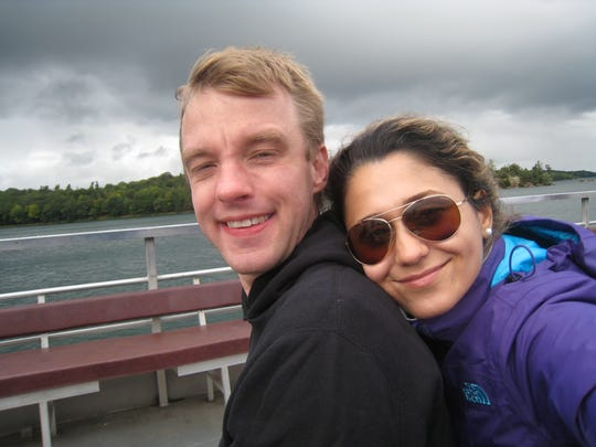 Ricky Smith and his wife Mona Ashraf Khorasani smiling in Thousand Islands, Ontario. Mona is currently not allowed to enter the U.S. due to the travel ban.