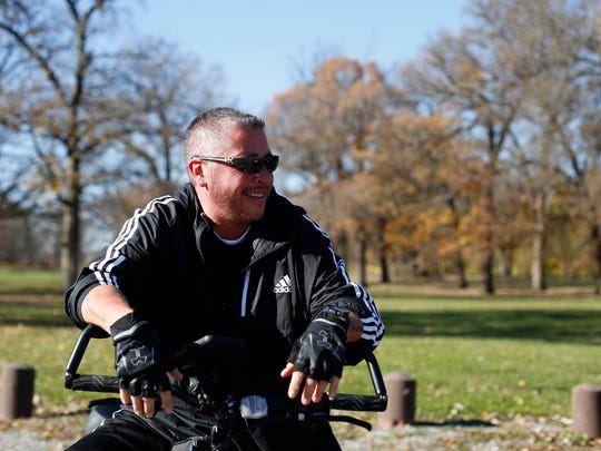 Aiden DeLathower gets ready to ride Sunday, Nov. 6, 2016, as he and his wife, Tammi, go for a bike ride on the trails on Credit Island in Davenport.