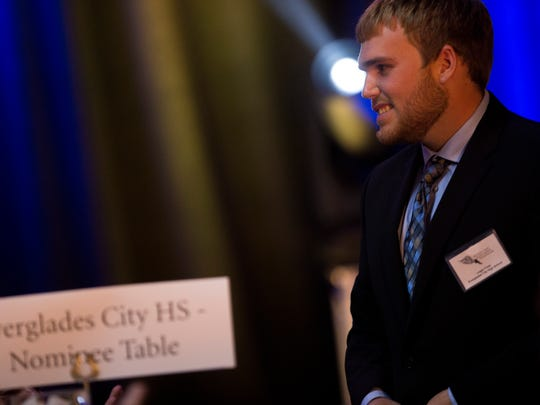 Everglades City graduate Logan Foss smiles as nominees are announced during the 2017 Winged Foot Scholarship Awards Banquet at the Naples Grand Beach Resort Thursday, May 25, 2017 in Naples.