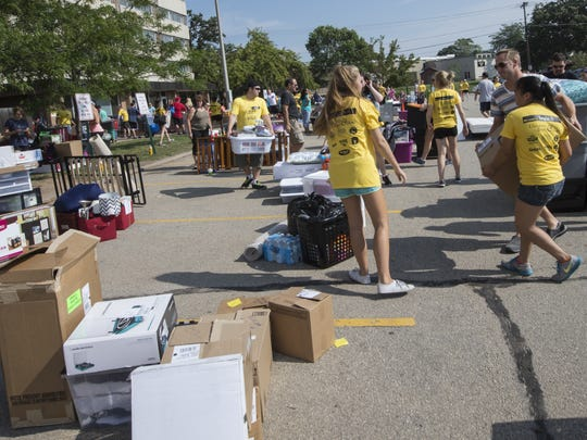 South Scott Hall parking lot acted as a drop-off site during move-in day for UW-Oshkosh students on Sunday, September 6, 2015.