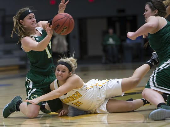 UW-Oshkosh's Emma Melotik (11) dives to the ground