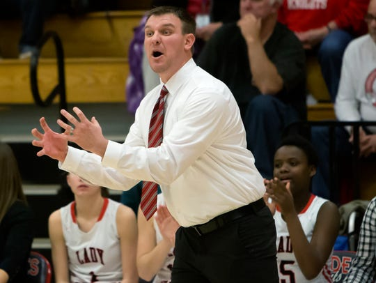 Lourdes Academy coach Reed Tyriver led the Knights to a 98-25 overall record in his five seasons.