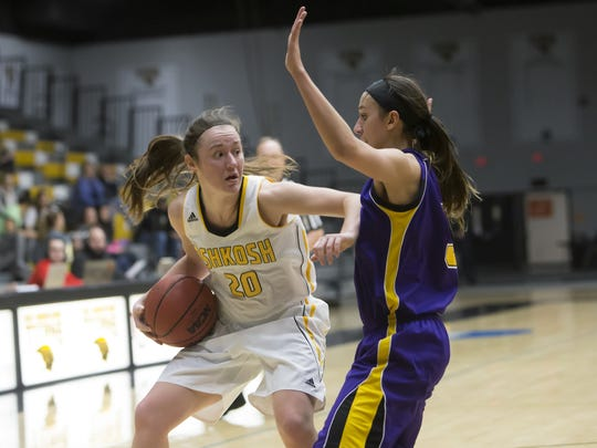UW-Oshkosh's Ashley Neustifter looks for room while being guarded by UW-Stevens Point's Sarah Gamillo on Saturday.