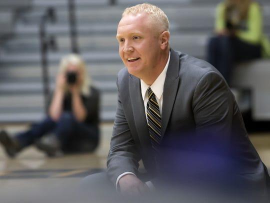 UW-Oshkosh head coach Brad Fischer watches the court